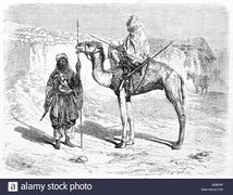 Old illustration of Tuareg men in the desert, Sahara, Algeria. Created by Hadamard after photo of Puig, published on Le Tour du Monde, Paris, 1861.jpg