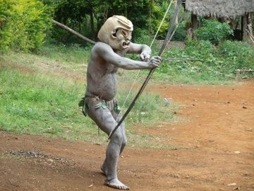 11786137-papua-new-guinea--september-16-mudman-warrior-aims-with-his-bow-at-goroka-tribal-festival-papua-new-.jpg